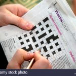 Solving A Quick Newspaper Crossword, London Stock Photo: 32946995   Guardian Printable Quick Crossword
