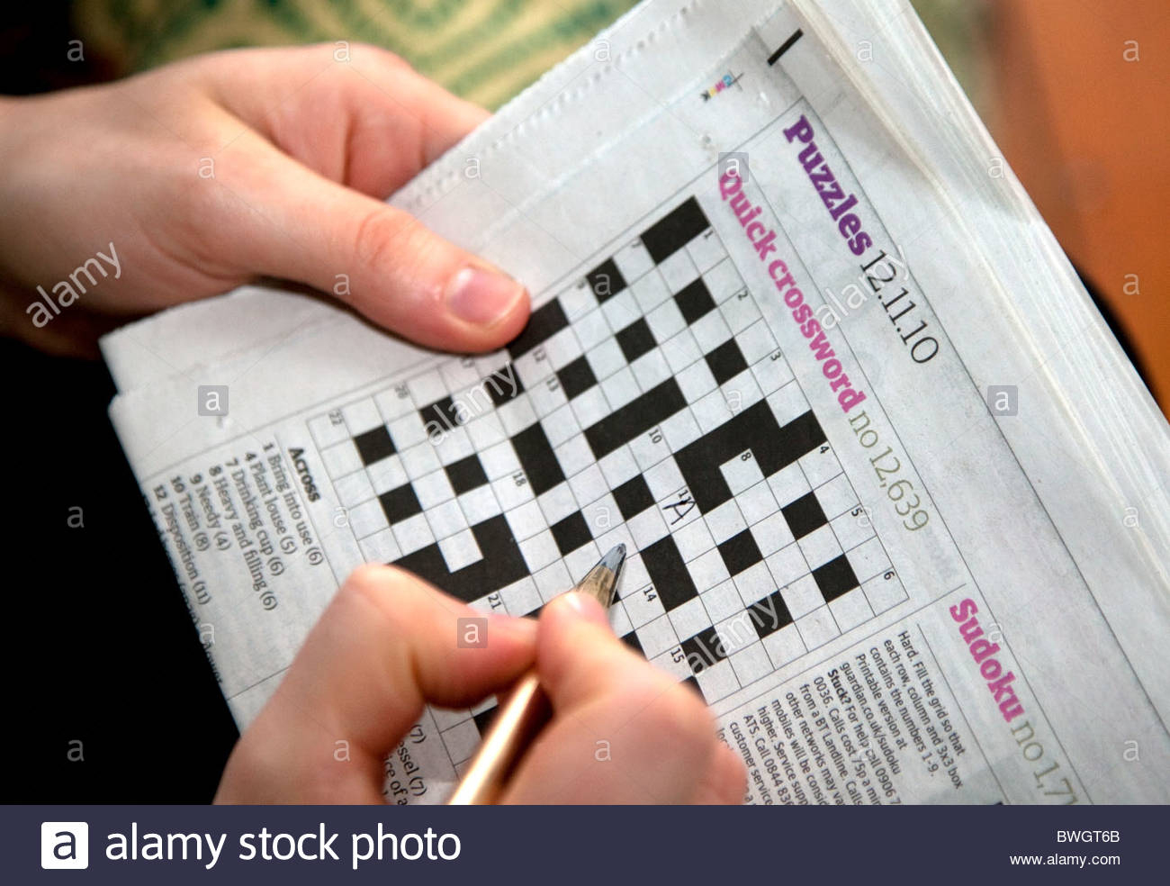 Solving A Quick Newspaper Crossword, London Stock Photo: 32946995 - Guardian Printable Quick Crossword